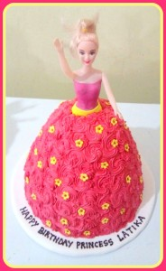 BARBIE DOLL CAKE WITH RED ROSETTES
