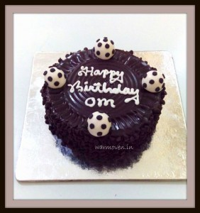 Chocolate cake with fondant football toppers