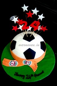 Football shaped cake with team scarf