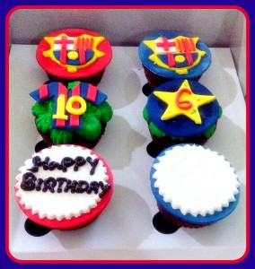 Football themed cupcakes with logo &jersey toppers