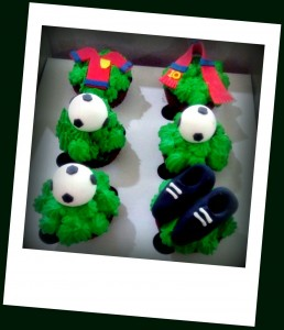 Cupcakes with football, jersey & cleats toppers