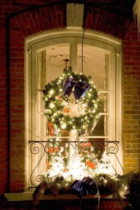 A Window Dressed with the Christmas Wreath & Lights